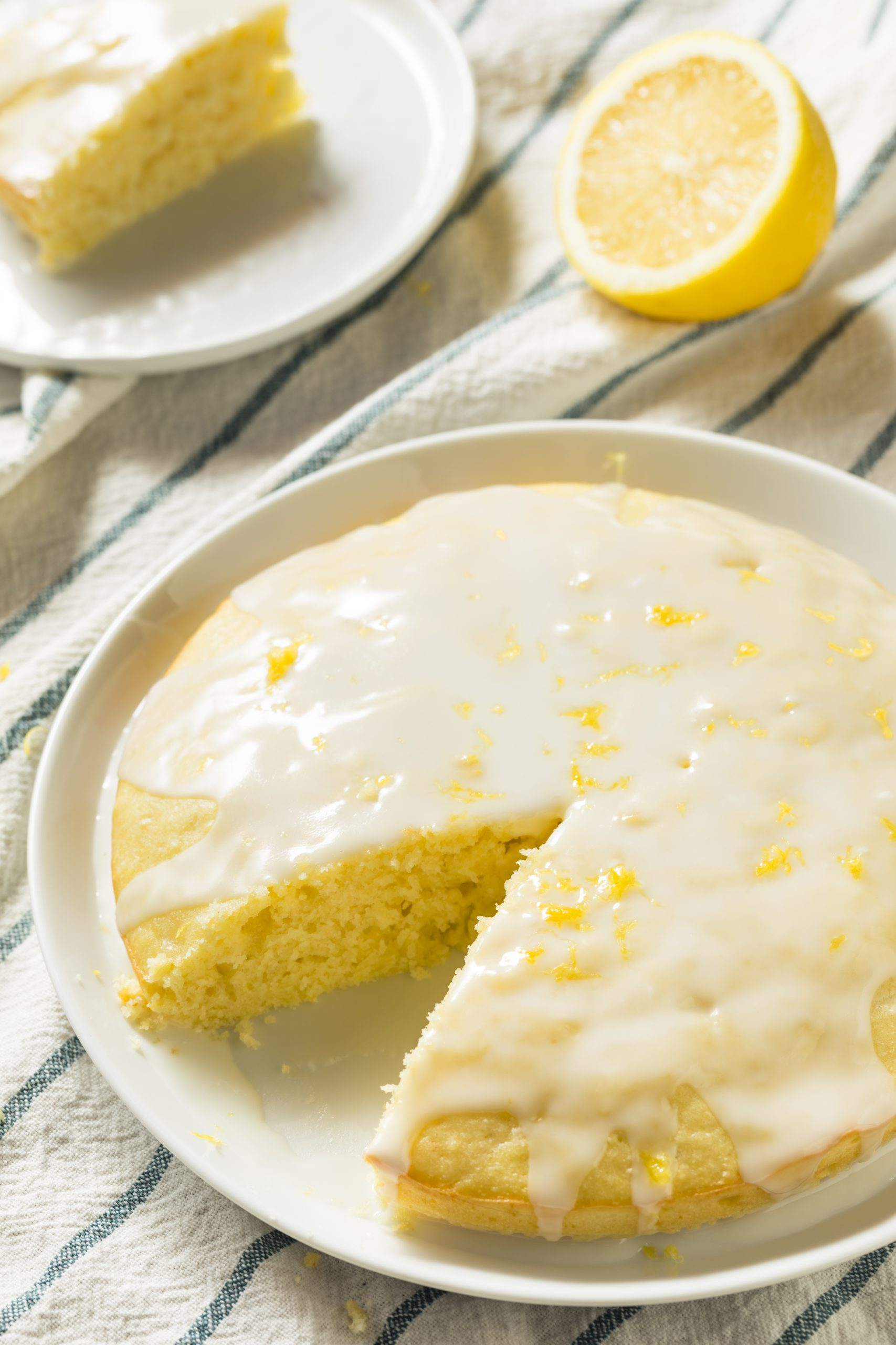 Looking for a delicious summery treat to make for your next dessert? The whole family is sure to love this Lemonade Poke Cake Recipe