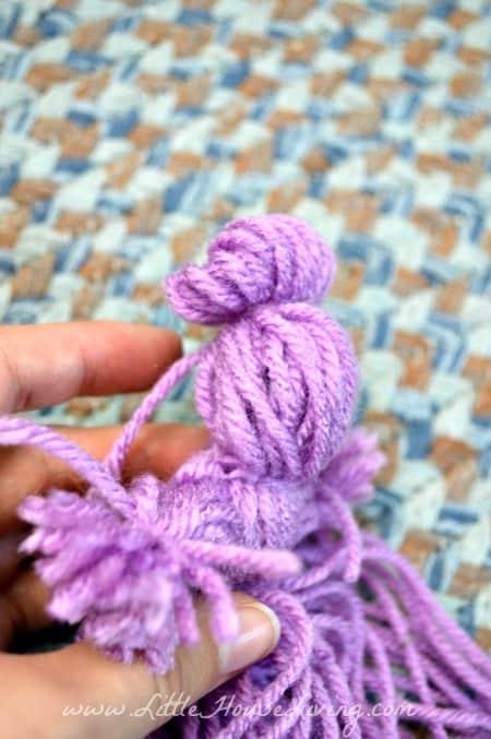 Tying a Bun on a Yarn Doll