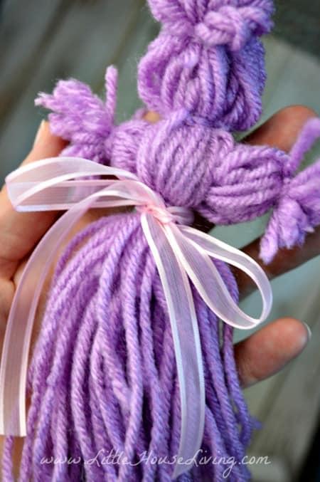 Adding a Bow to a Yarn Doll