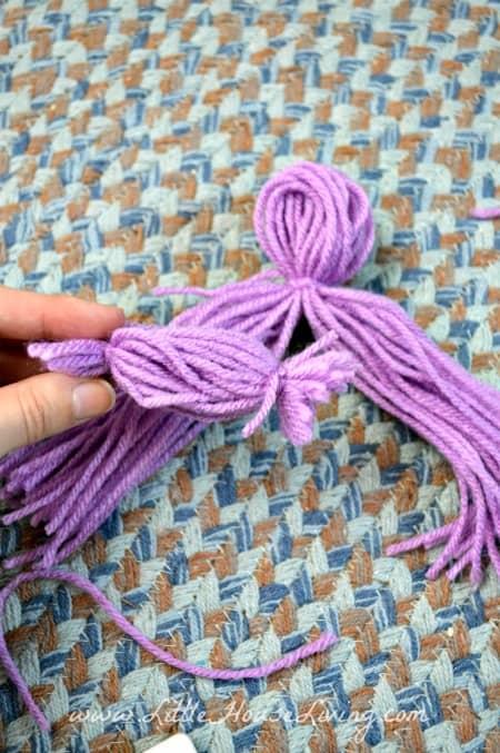 Inserting Arms on Yarn Dolls