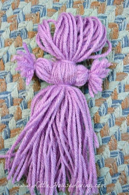 Adding in Arms on Yarn Dolls
