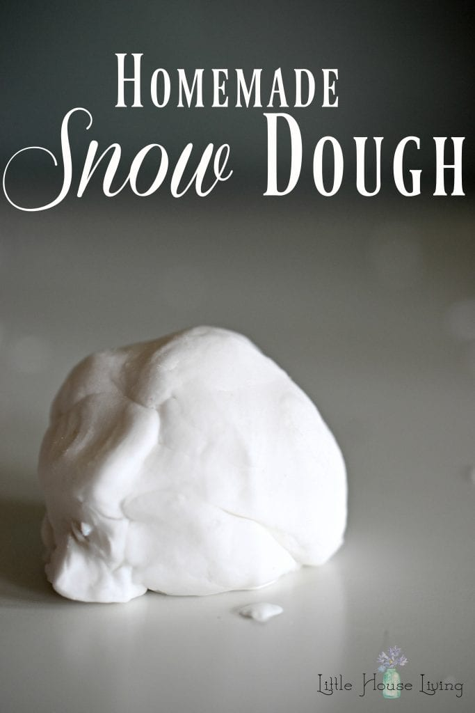 Give your little ones something different to do with this quick and easy Homemade Snow Dough Recipe! You only need 2 ingredients to make this frugal, fun project! #makeyourown #homemadesnowdough #homemade #diysnowdough